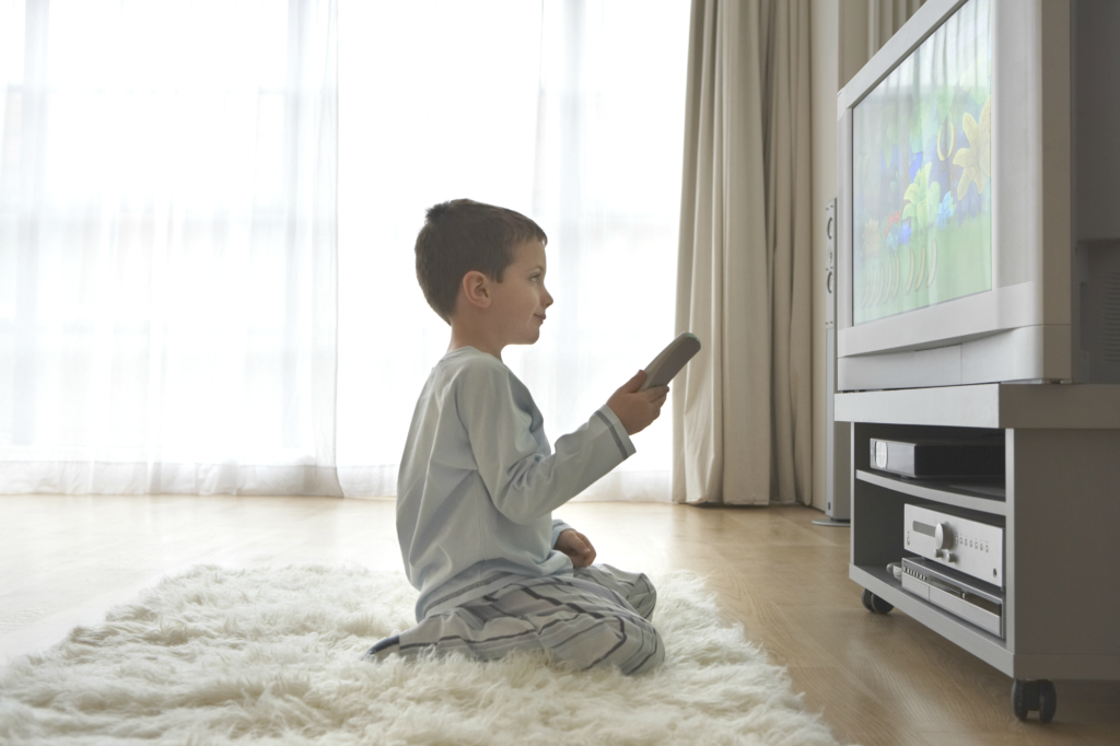 Kid watching TV on knees white rug 4000x2666 lighter1 1024x682